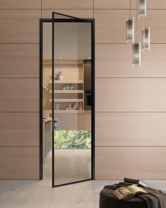 Szklane drzwi z niewidoczn o cie nic w czarnym kolorze for Design office y z